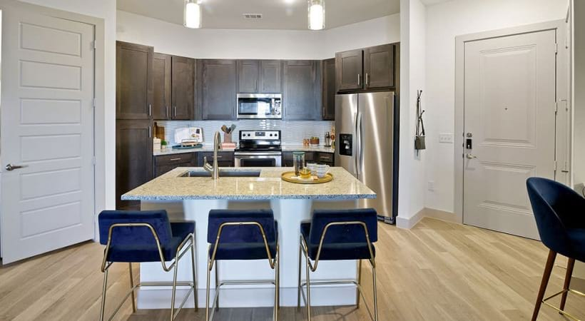 Spacious kitchen with modern lighting at our luxury apartments in North Dallas, TX
