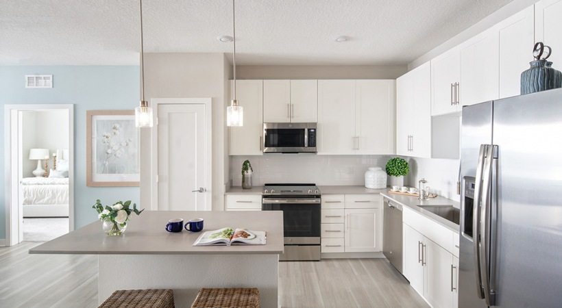 Open-concept kitchen with island at our Clearwater apartments for rent