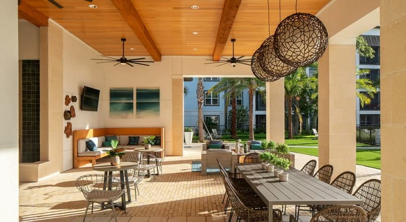 Poolside lounge with seating areas at our waterfront apartments in Clearwater, FL