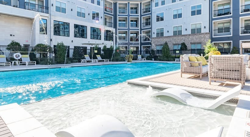 Resort-style pool with sun deck at our modern apartments for rent in Allen, TX