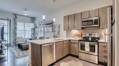 Kitchen with stainless steel appliances at our upscale apartments for rent in Allen, TX