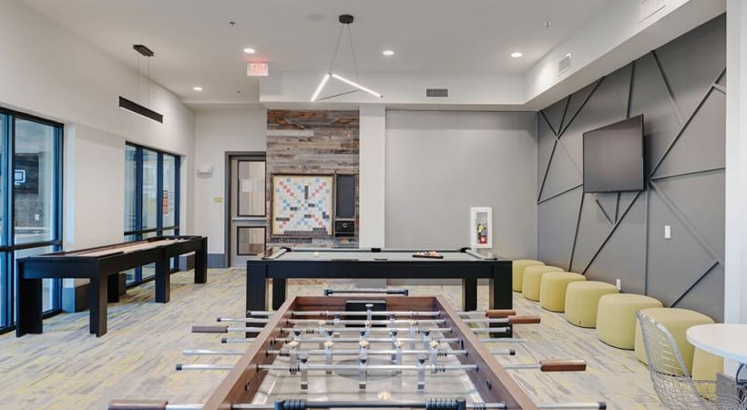 Game room at our Allen apartment clubhouse