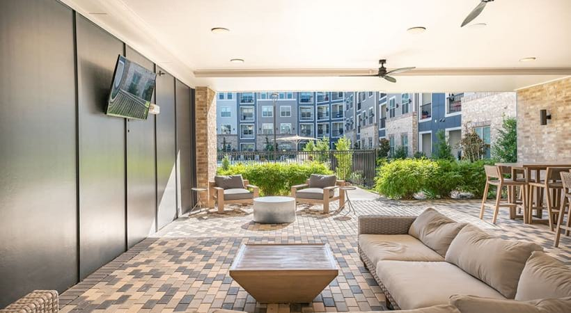 Outdoor lounge with HDTV at our modern apartments for rent in Allen, TX