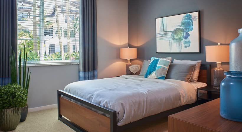 large window brightens spacious bedroom