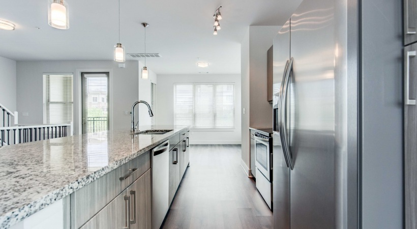 Kitchen with stainless steel appliances at our Flatiron apartments Broomfield Colorado