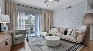 Spacious living rooms with an accent wall and modern decor at our luxury apartments in Plano