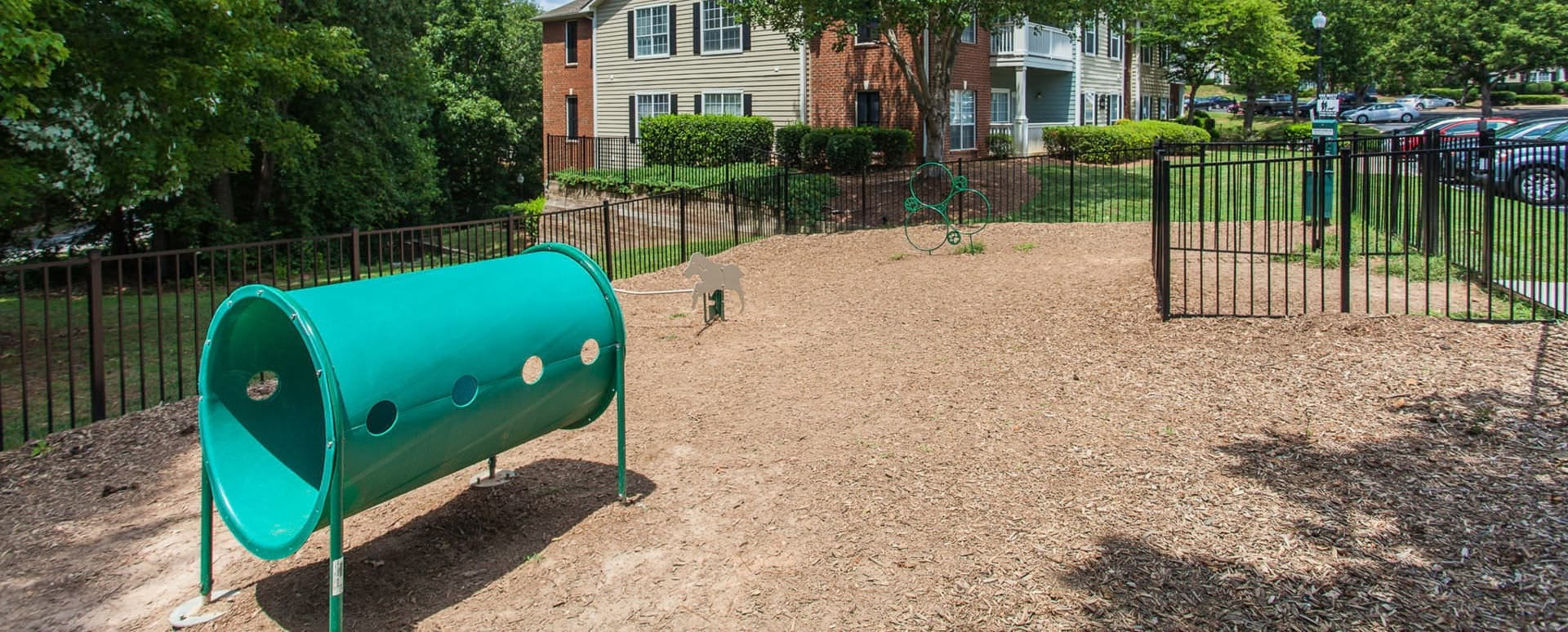 equipment in gated, outdoor bark park