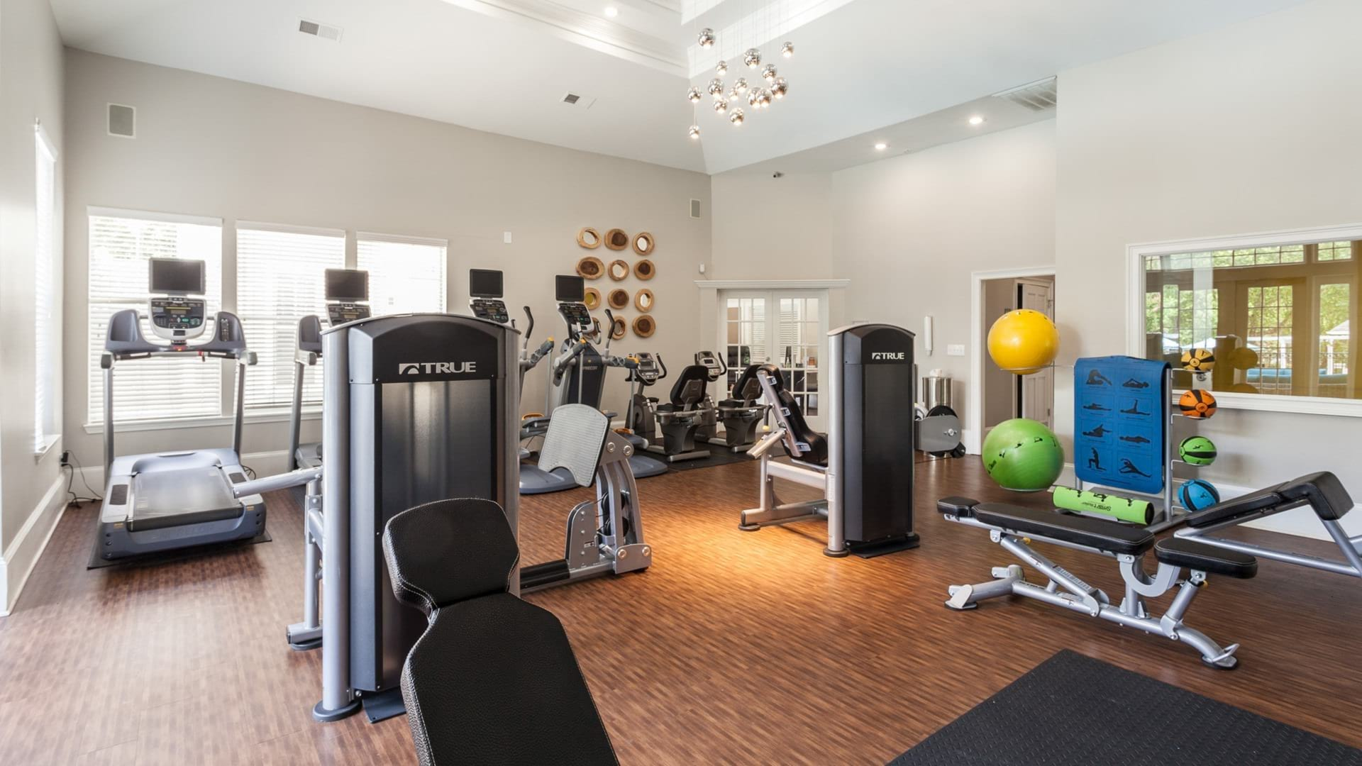 spacious fitness center with vaulted ceiling