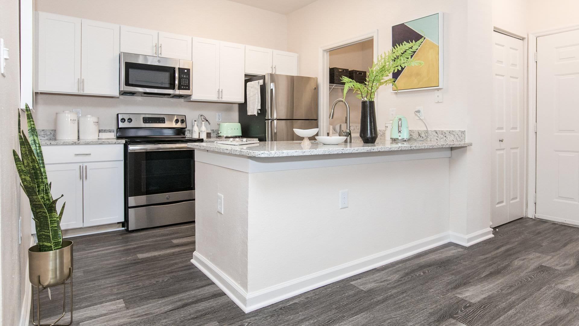 c-shaped kitchen, brightly lit