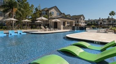 Photo of resort-style outdoor swimming pool with sun deck