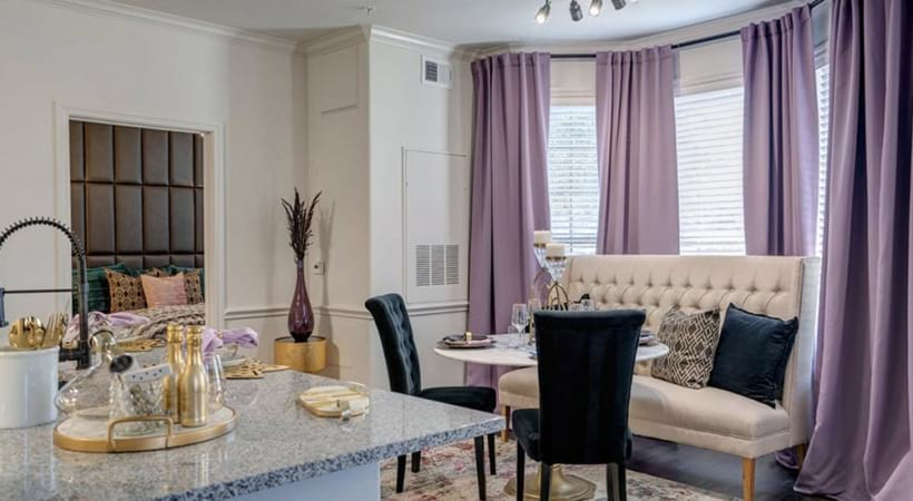 Dining room space with bay windows to let in lots of light