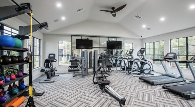 Fitness center with cardio machines, weight machines, and free weights