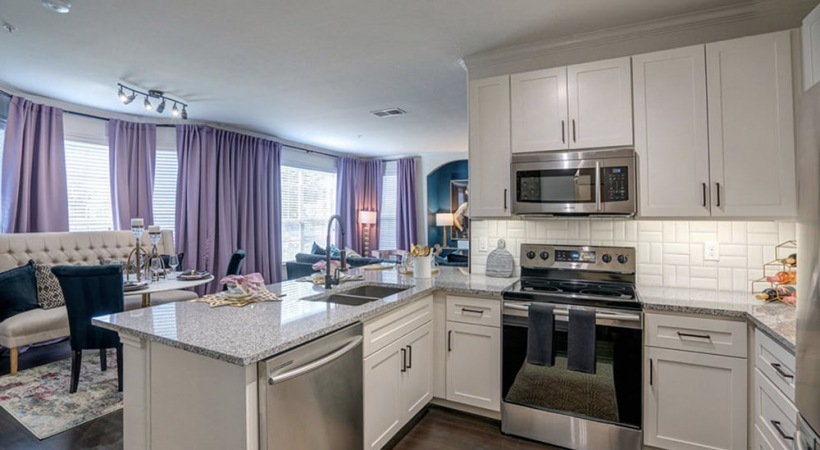 Kitchen area with stainless steel appliances and granite countertops