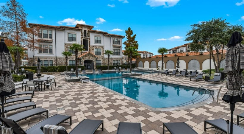 Resort-style pool with sun deck at our luxury apartments in Irving, TX