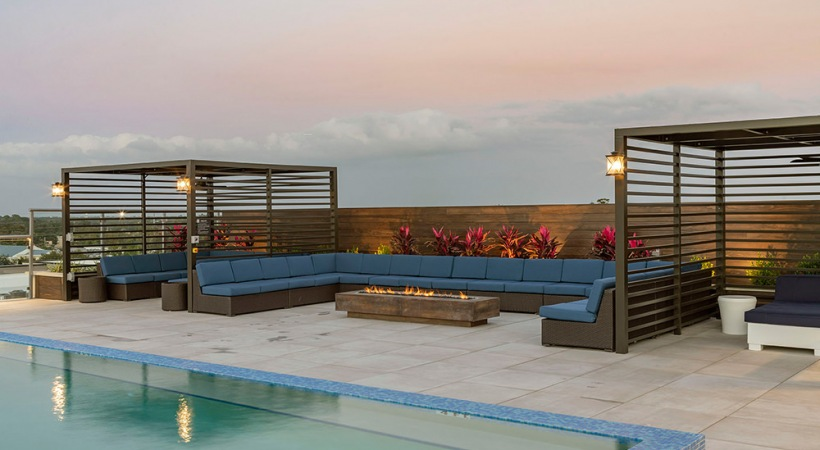 Poolside Lounge with Cabanas and a Fire Pit