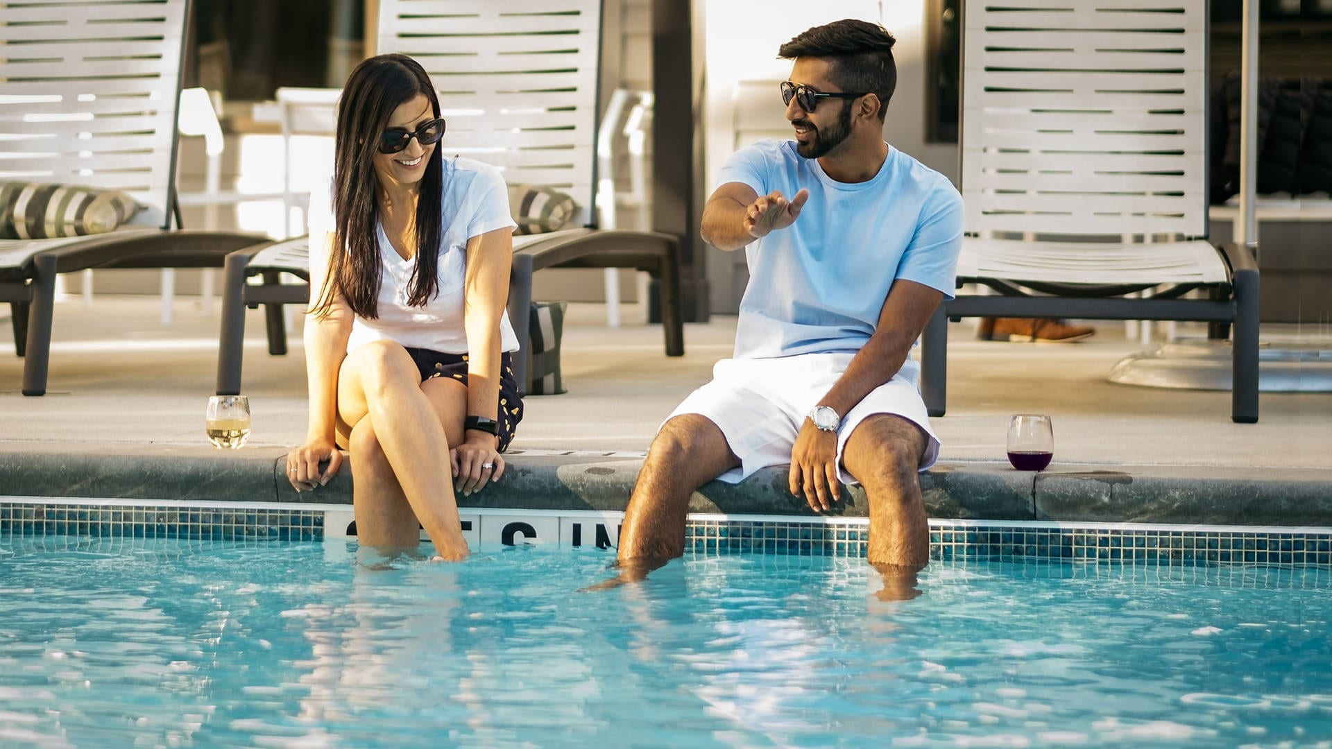 couple at pools edge