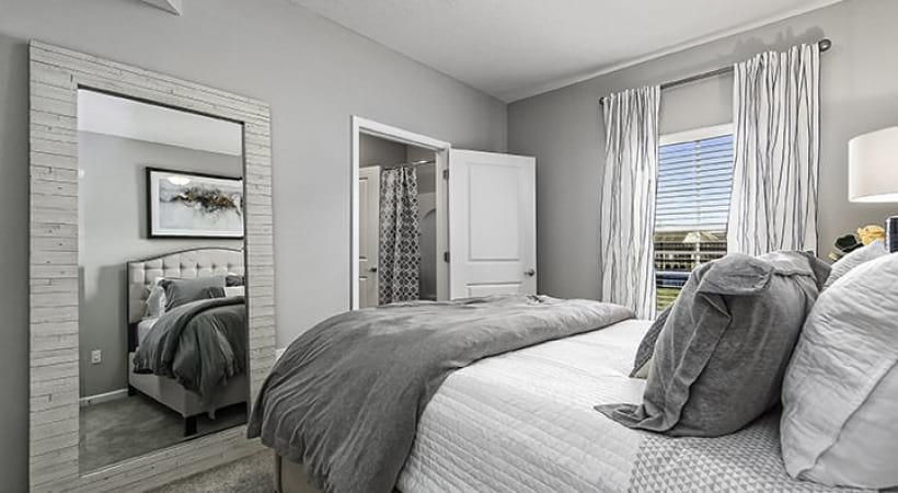 cozy, furnished bedroom with carpet and bathroom access