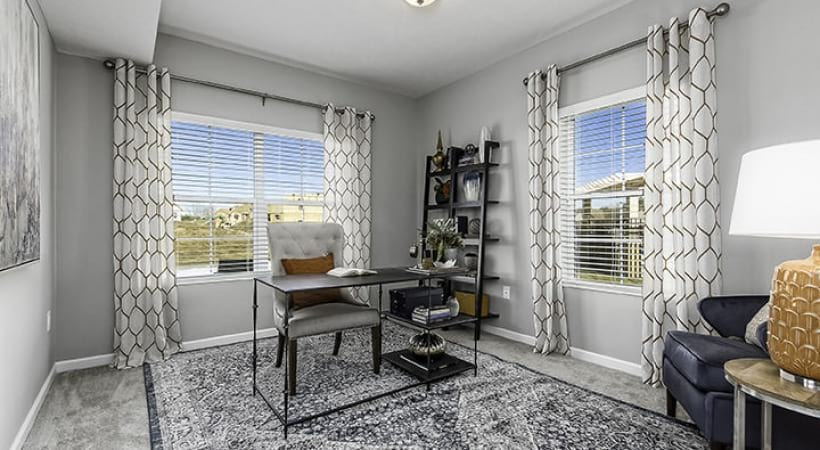 office area with large windows providing ample natural light