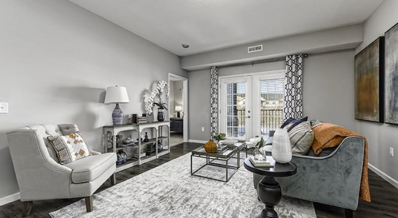 light in spacious living room with access to private balcony