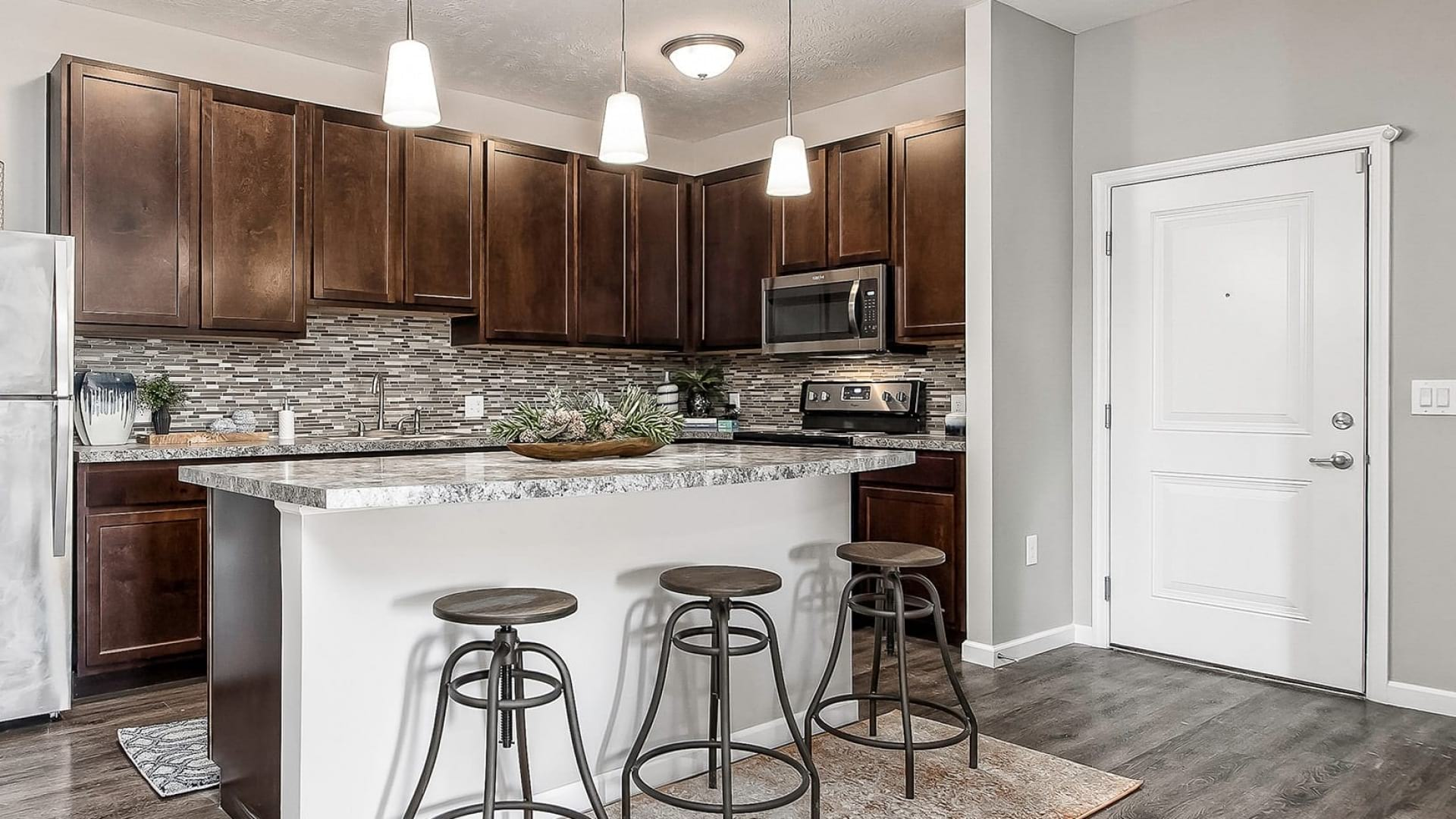 open concept kitchen with pendant lighting over island