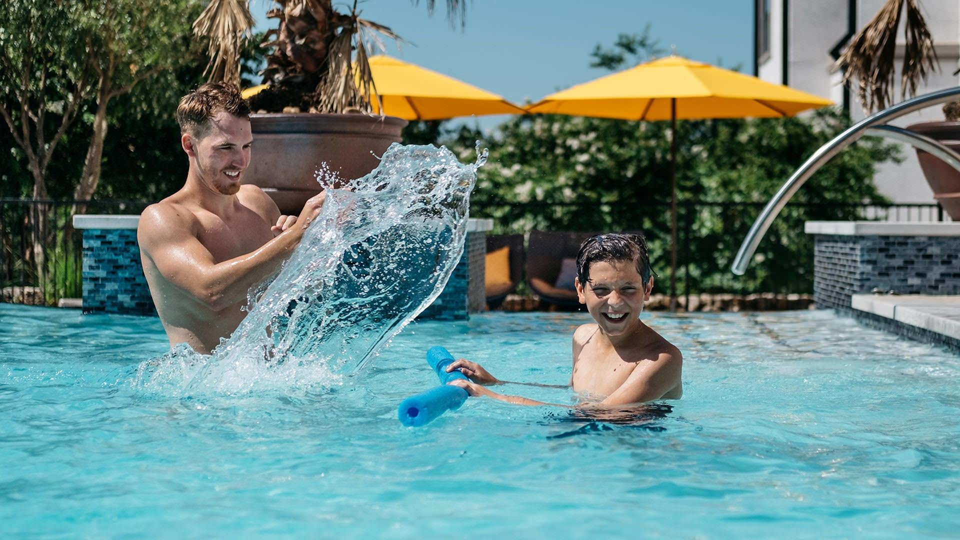 residents playing in resort style pool