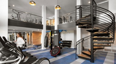 ample lighting throughout roomy, two-story fitness center