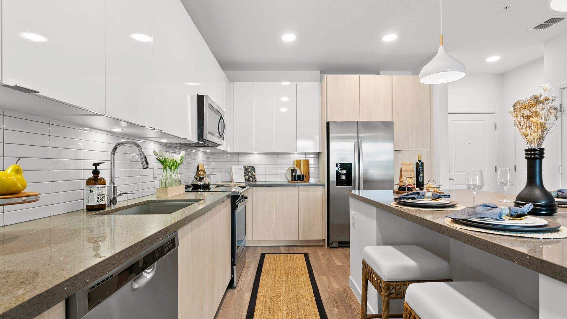 ample counter space and storage in kitchen brightened by recessed lighting