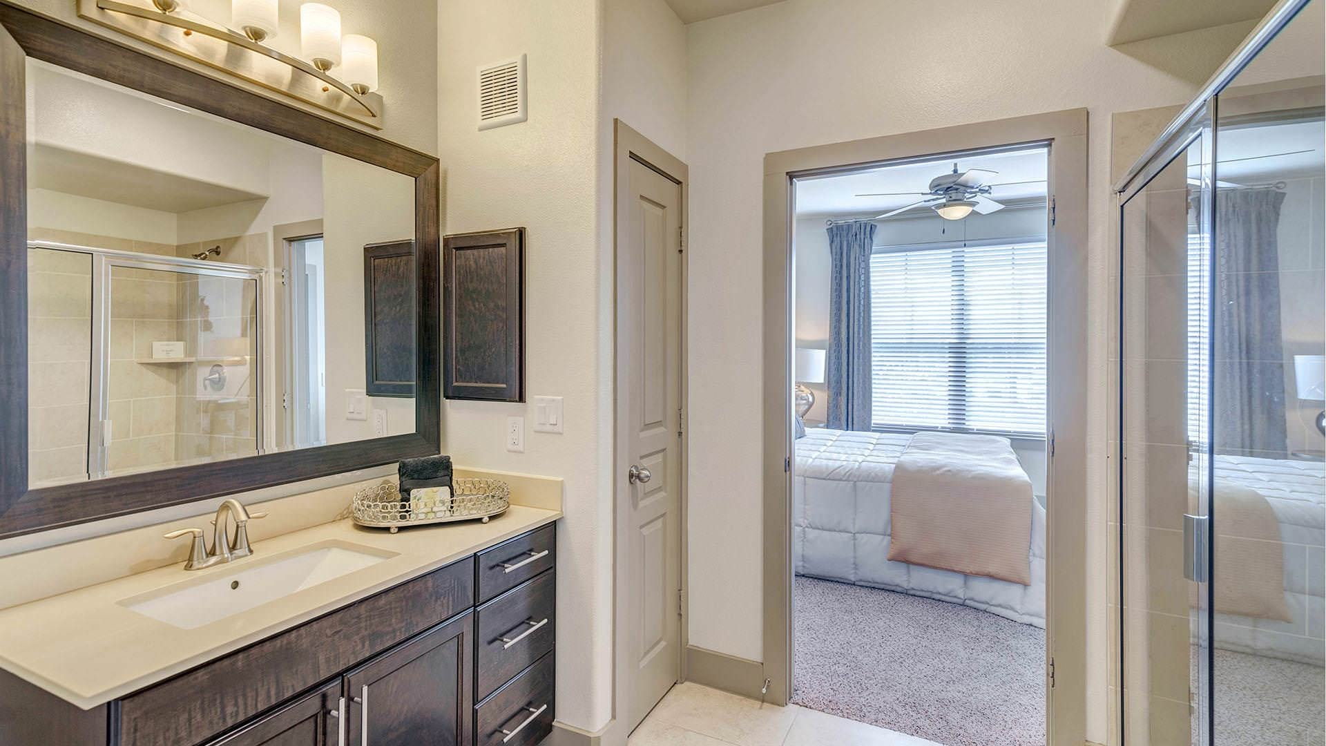glass enclosed, walk-in shower in well lit bathroom