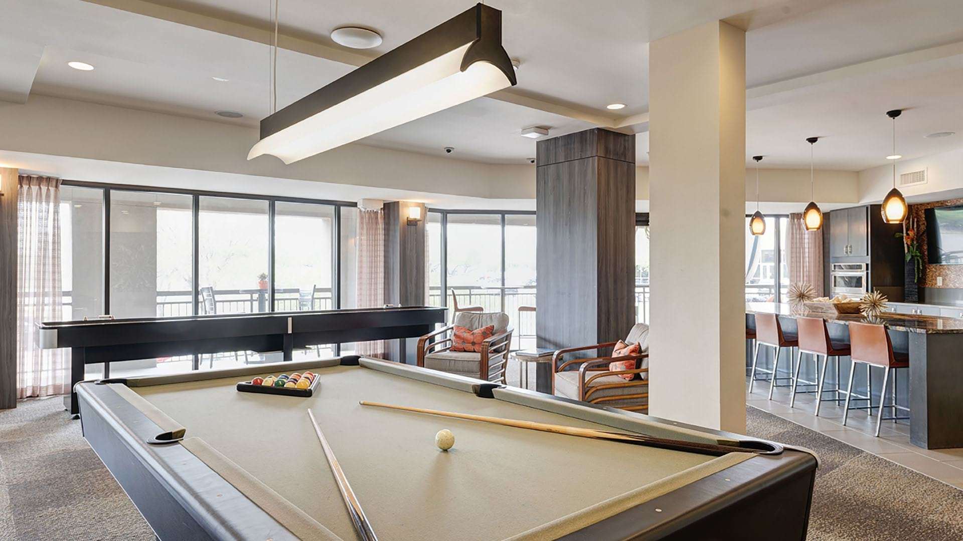 billiards table in bright clubhouse