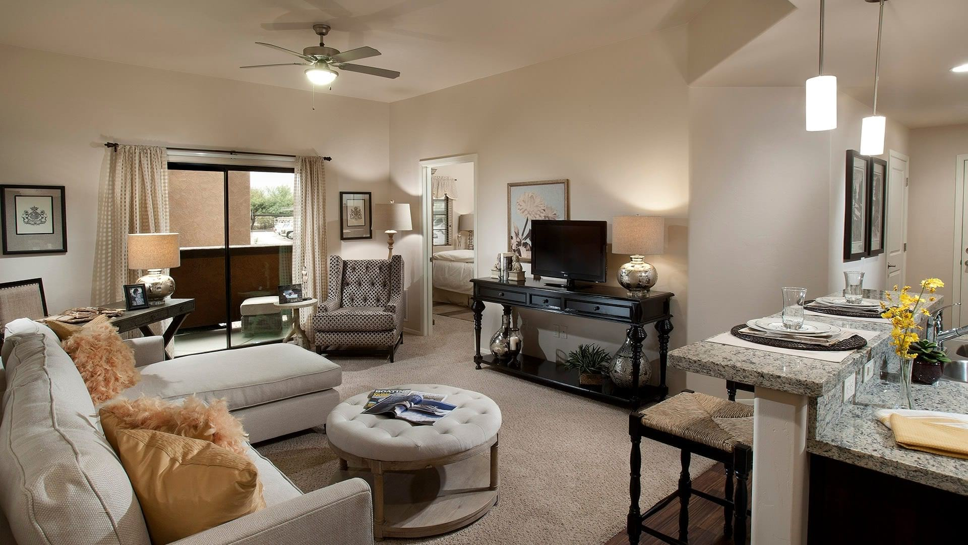 spacious living room with sliding glass door access to private balcony
