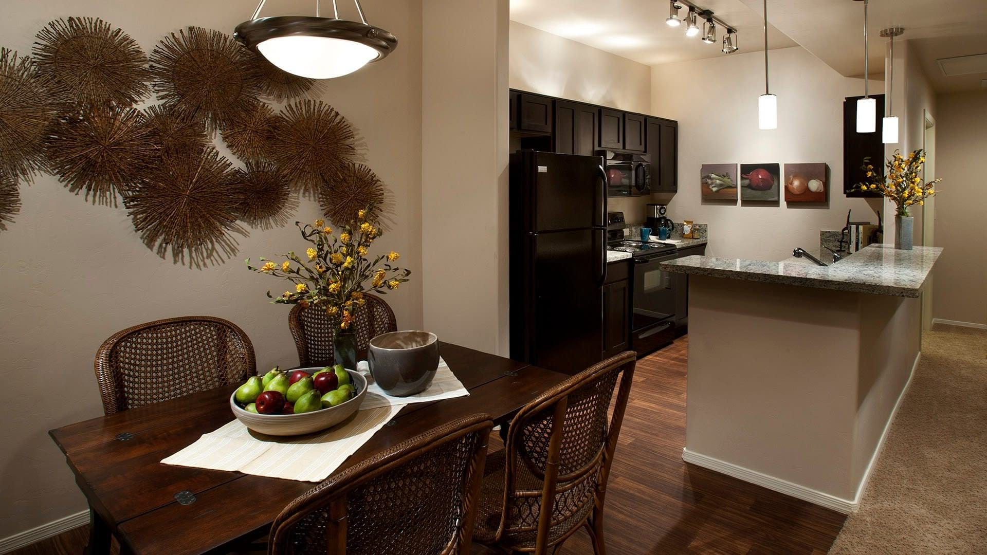 dining area with overhead light adjacent to kitchen