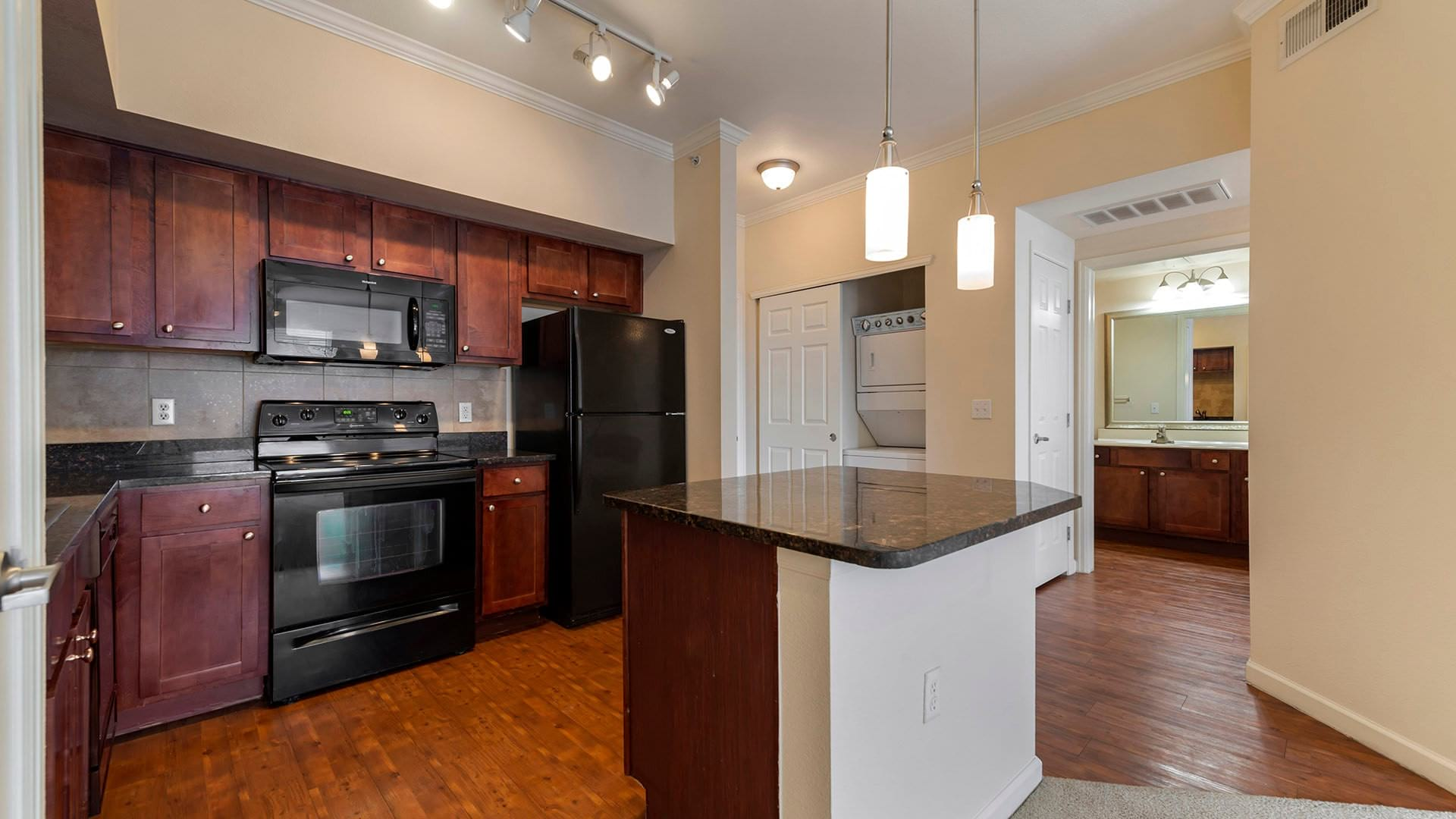 open kitchen with island, and track lighting