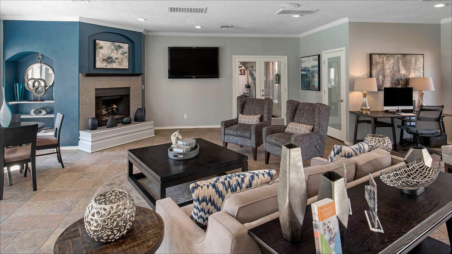 fireplace, workspace and social seating areas in bright clubhouse