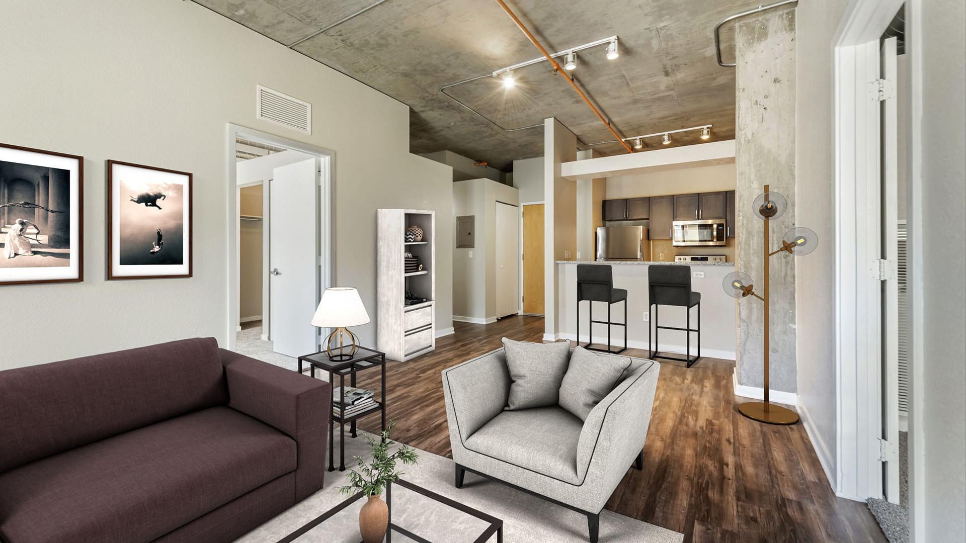 furnished living room with track lighting adjacent to kitchen