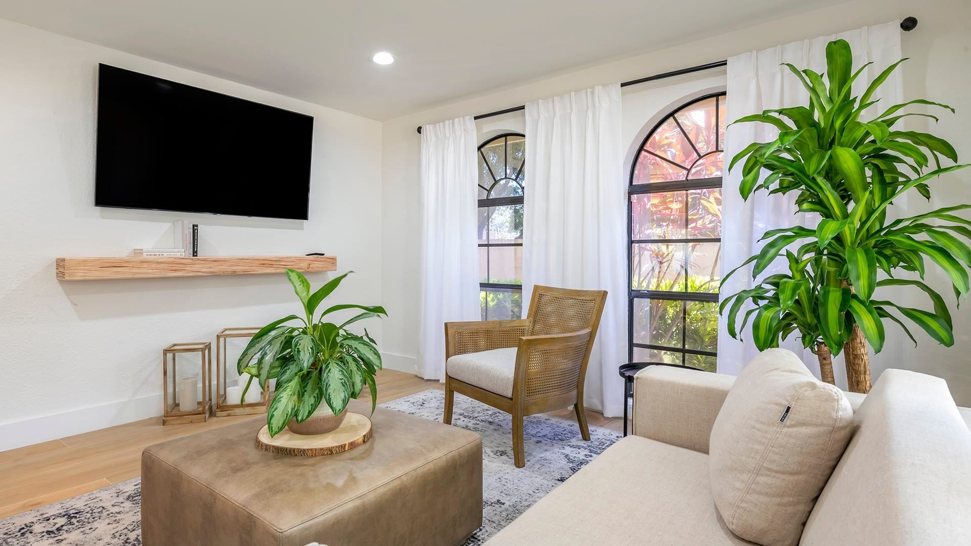 picture windows brighten clubhouse with sofa and wall mounted television