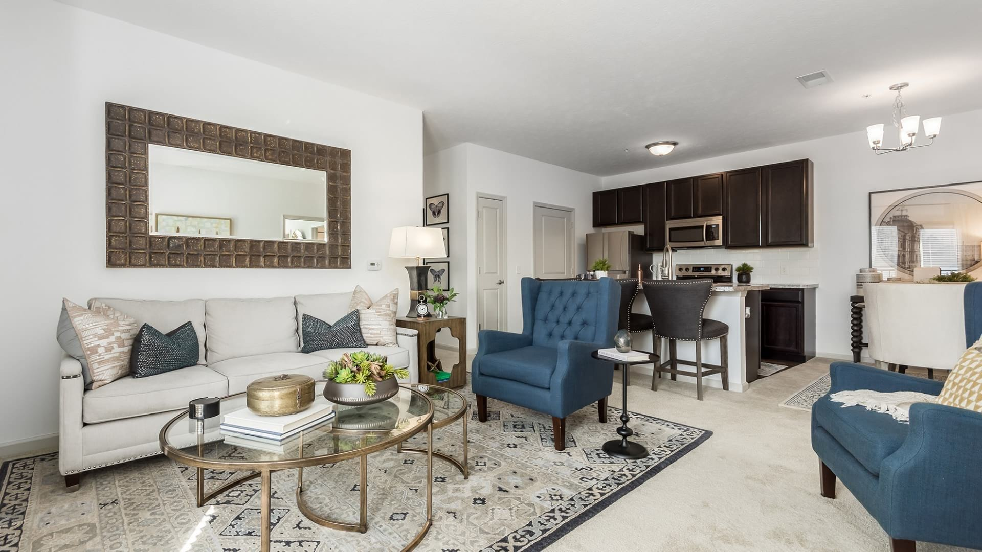 large, carpeted living room open to kitchen