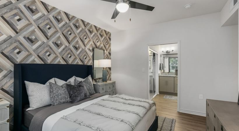 Bedroom with accent wall at our modern apartments in CityLine Richardson