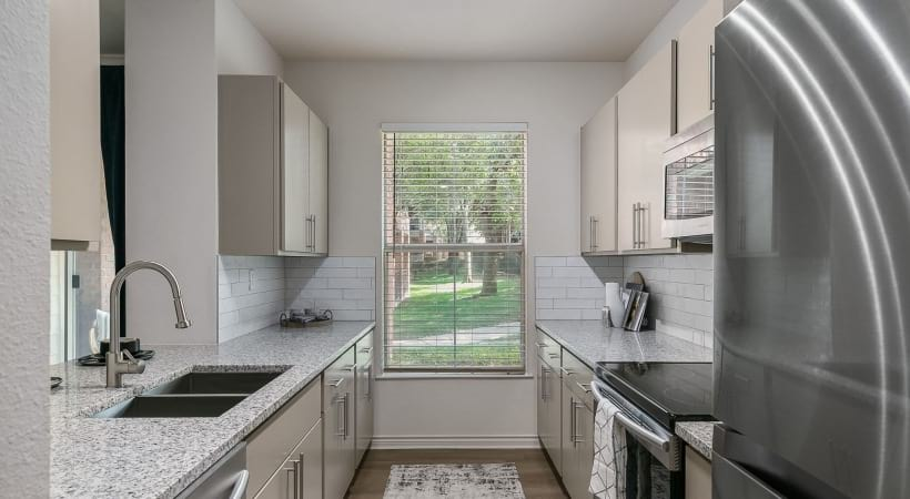 Kitchen with granite countertops at our luxury apartments near UTD
