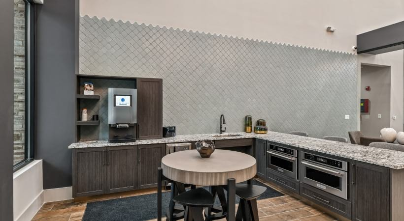 Our Las Colinas luxury apartment clubhouse with coffee bar and dining area