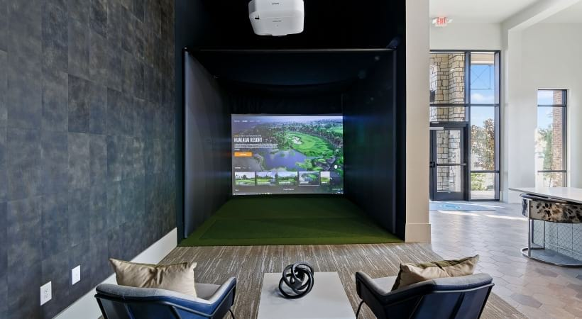 Our Little Elm apartments with golf simulator