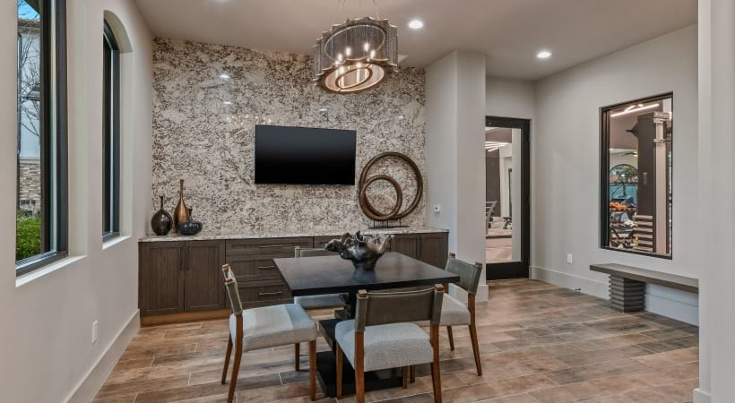 Our Irving apartment clubhouse with seating areas and HDTV