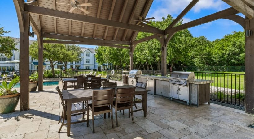 Outdoor sun deck with gas grills at The Colony apartments