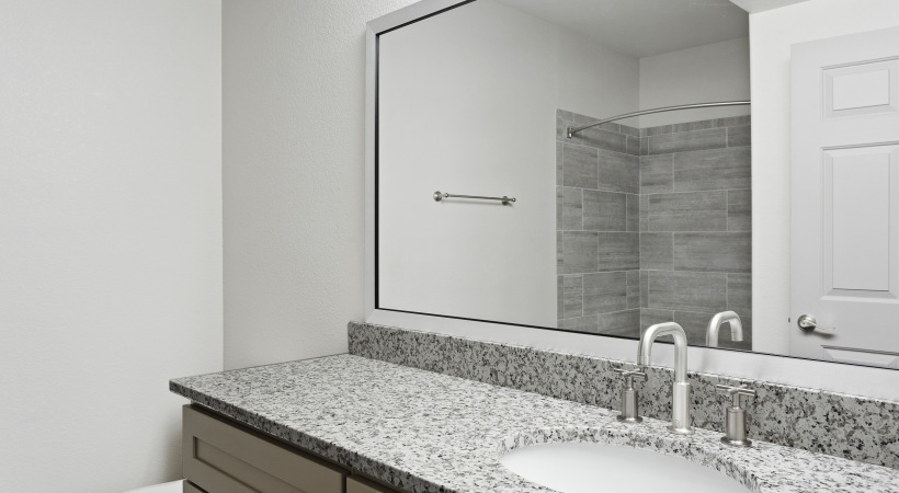 Renovated Bathroom with Granite Counters