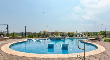 Resort-style pool with loungers at our Broomfield apartments for rent