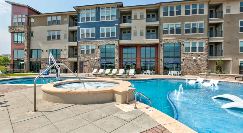 Resort-style pool and spa at our luxury apartments near Boulder, CO