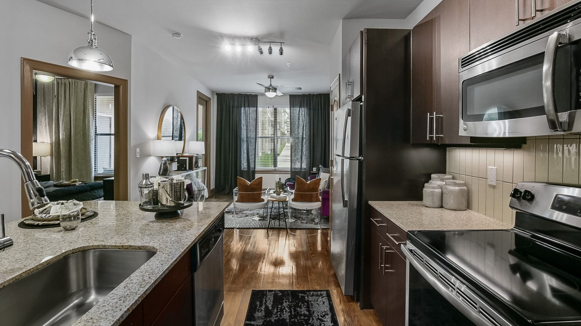 Kitchen with stainless steel appliances at our apartments for rent in Frisco, TX