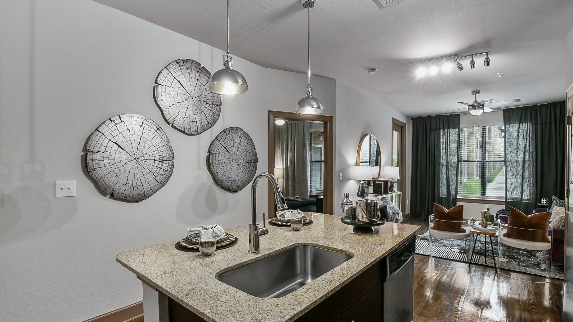 Open-concept kitchen and living room at our Frisco apartments for rent
