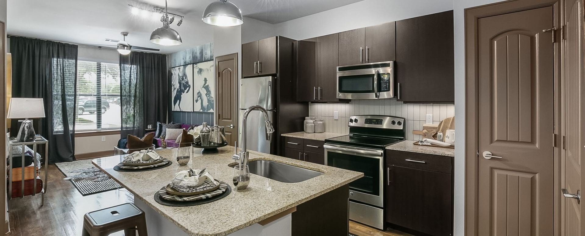 Kitchen island at Frisco apartments for rent