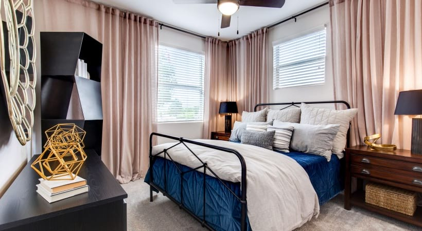 Spacious Apartment Bedroom with Ceiling Fans