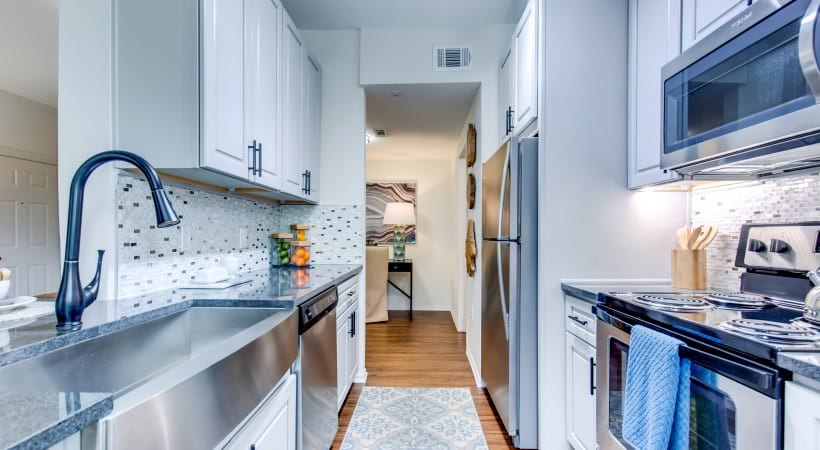 Kitchen with Stainless Steel Appliances and Gooseneck Faucets